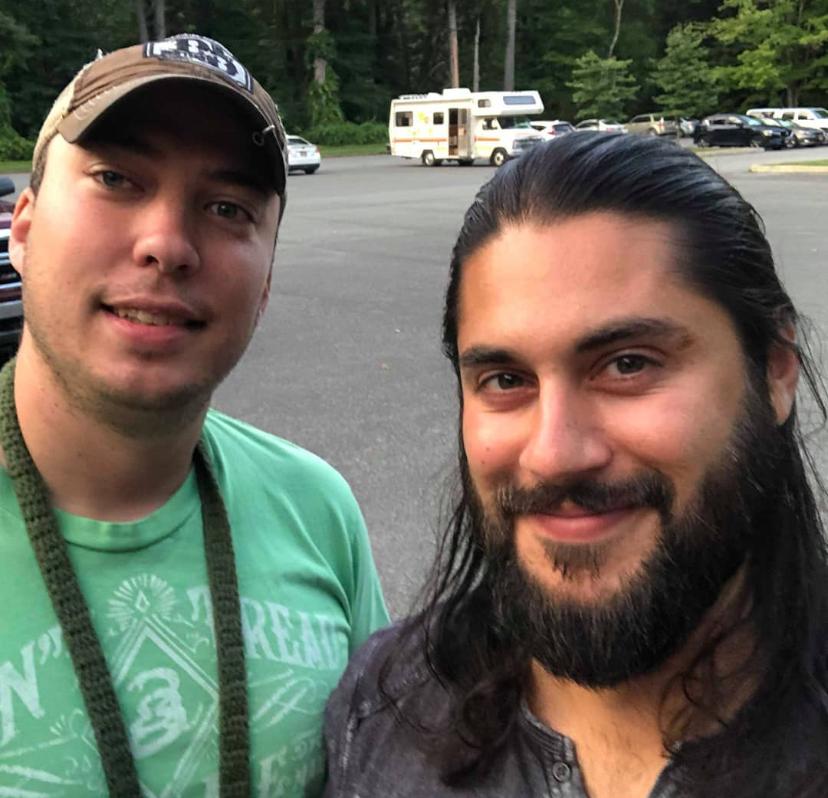 Maverick Mike and Captain Matt looking at summer time lighting at a picnic