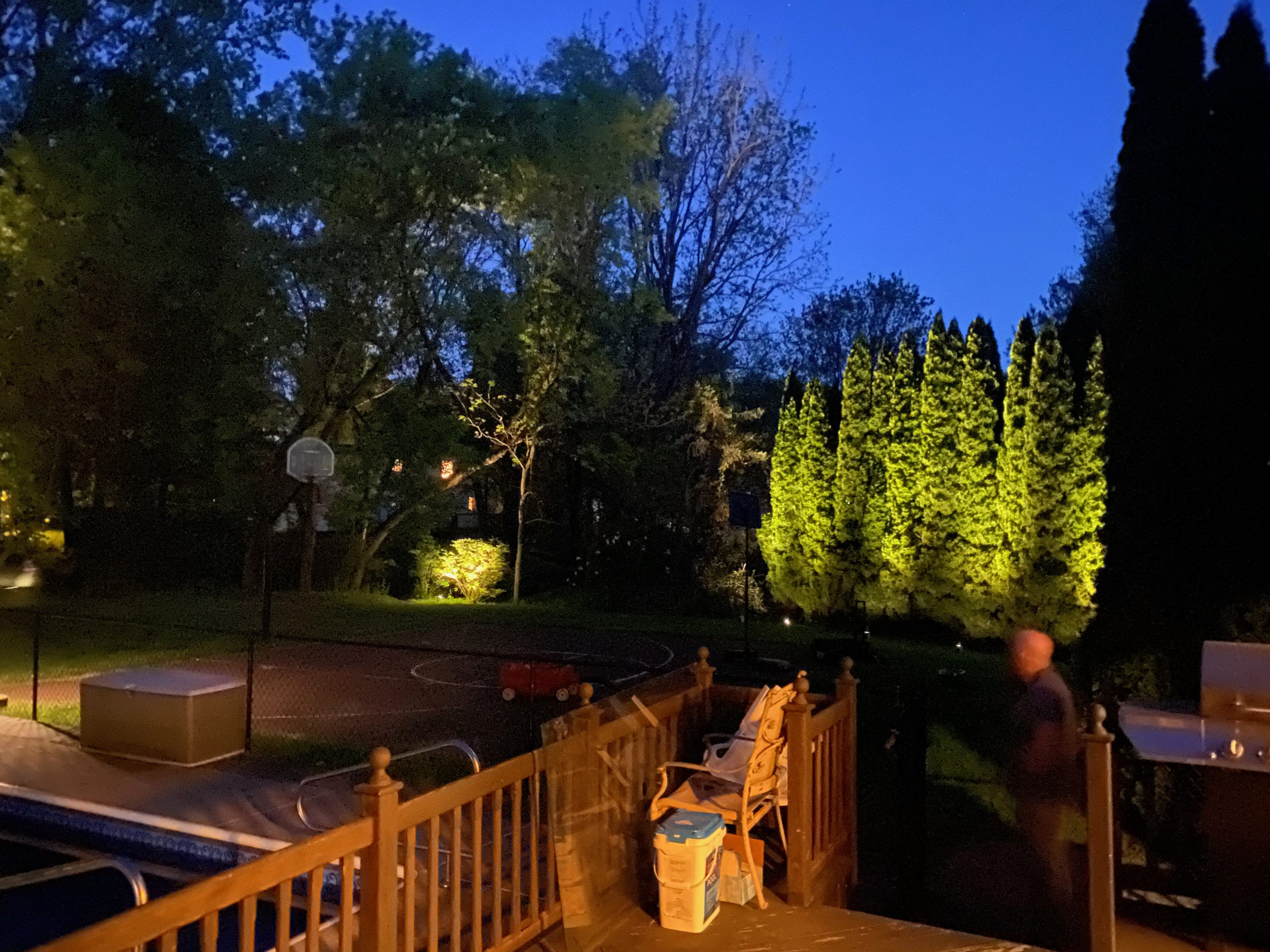 sitting on a porch looking out at landscape lighting