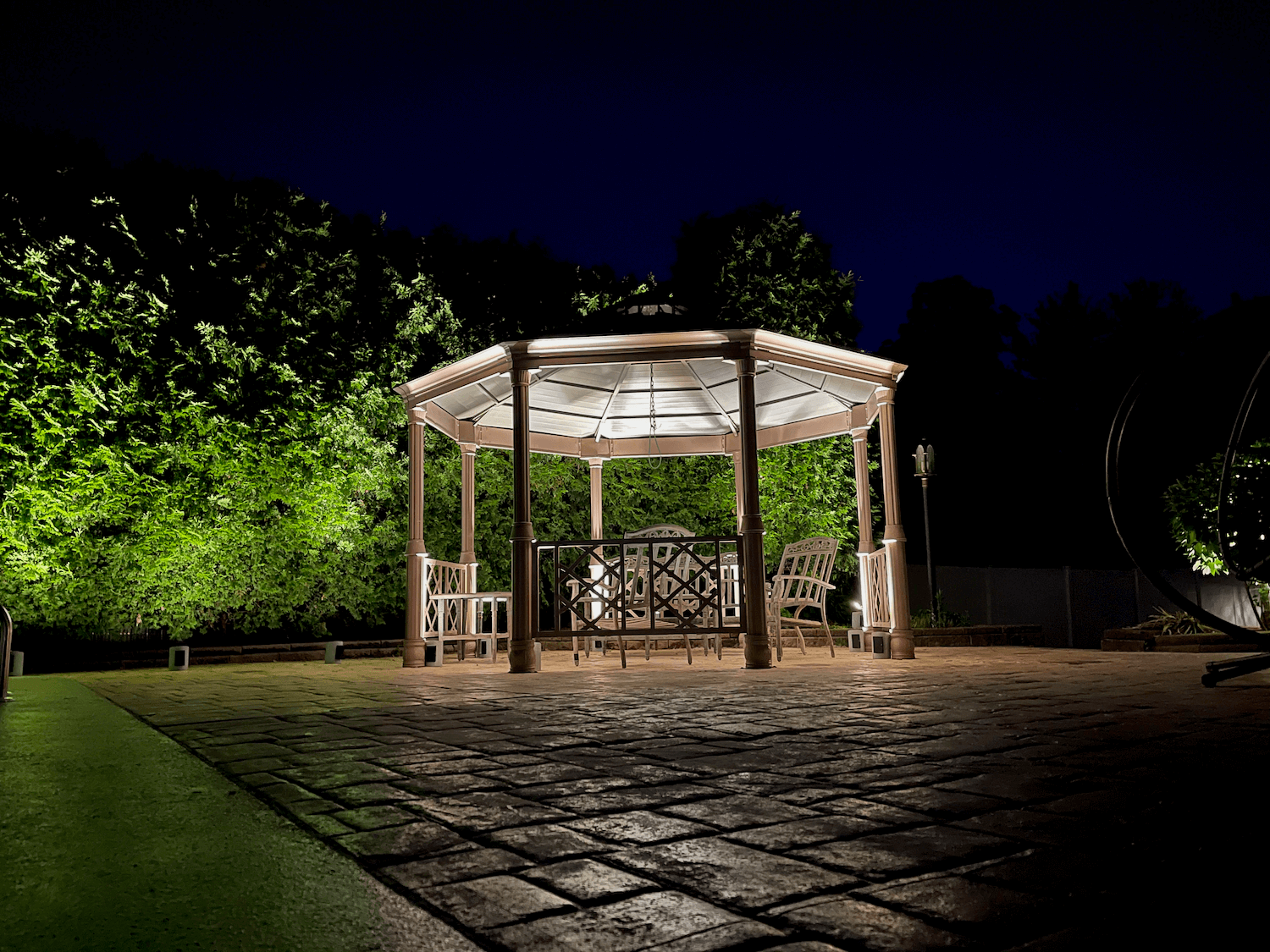 A gazebo with landscpae lighting to see at night